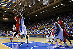 15 November 2014: Fairfield's Mike Kirkland (0) shoots over Duke's Amile Jefferson (21). The Duke University Blue Devils hosted the Fairfield University Stags at Cameron Indoor Stadium in Durham, North Carolina in an NCAA Men's Basketball exhibition game. Duke won the game 109-59.