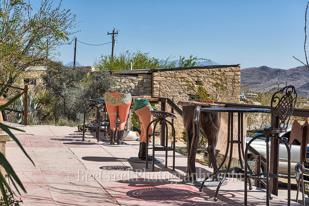 It can't much quirkier than this in Terlingua with womens buttock and legs as a bar stool not to mention the horses ass stool. These bar stools were created by one of the many artist that live in the area. I think there is a message here but I won't speculate any farther.  This is the front porch at the Starlight Theatre restaurant waiting area and of course theres alway a good dog enjoying the shade here. At night this is a happening spot especially after the tourist eat and go home the locals move in for some dancing and drinking. You could say the party is out here.