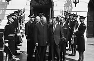 March 31st 1969, Washington, DC, USA. United States President Richard Nixon and French President Charles de Gaulle exiting the White House for the funeral of President Dwight Eisenhower on March 31, 1969. The eulogy was later delivered by President Richard Nixon during funeral services at the National Cathedral.