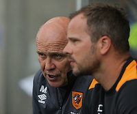 Manager of Hull City, Mike Phelan (L) during the Premier League match between Swansea City and Hull City at the Liberty Stadium, Swansea on Saturday August 20th 2016