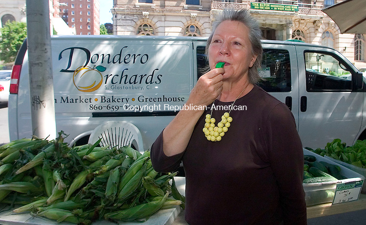 WATERBURY, CT -10 JULY 2008 -071008DA03- Founder of the Farmer's Market, on the Waterbury Green, Marianne Vandenburg, blows a whistle to start off the opening of the market Thursday. Vendors will offer fresh fruits, vegetables, artisan breads, herbs flowers, sea food, and much more. The market and will continue 18 weeks through the end of October each Thursday 11 a.m. to 3 p.m.  Darlene Douty/Republican-American