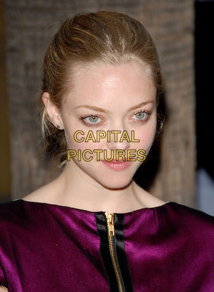 AMANDA SEYFRIED.The Sony Picture Classics L.A. Premiere of 'Mother and Child' held at The Egyptian Theatre in Hollywood, California on .April 19th, 2010                 .headshot portrait purple pink silk satin black zip zipper make-up beauty hair up                                                     .CAP/RKE/DVS.©DVS/RockinExposures/Capital Pictures.