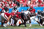 Stephen Louis (12) of the North Carolina State Wolfpack fumbles the ball during first half action against the South Carolina Gamecocks in the Belk College Kickoff at Bank of America Stadium on September 2, 2017 in Charlotte, North Carolina.  The Gamecocks defeated the Wolfpack 35-28.  (Brian Westerholt/Four Seam Images)