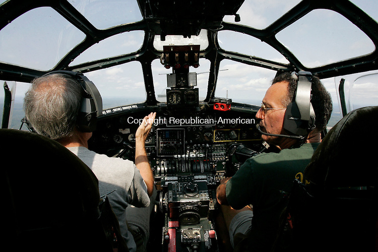 STRATFORD, CT 9/06/07- 090607BZ11- B-24 Liberator pilot's Jeff Whitesell, of Los Angeles, CA, left, and John Purdy, of New Milford, CT, talk during a flight from Sikorsky Airport to Waterbury-Oxford Airport Thursday. <br /> Jamison C. Bazinet Republican-American