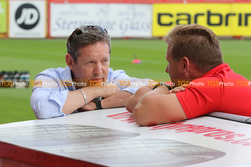 Stevenage Chairman, Phil Wallace chats with MK Dons Manager, Karl Robinson, prior to kick-off during Stevenage vs MK Dons, Friendly Match Football at the Lamex Stadium on 30th July 2016