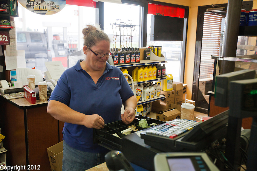 Wendy Bell at work at her first job in Williston, North Dakota at Lonnies Truck stop making $12/hour. She was fired a couple of weeks later  for not showing up to work. She now works as a security guard making $18/hour.
