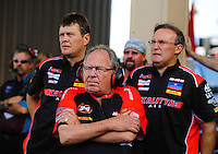 Jul. 23, 2011; Morrison, CO, USA: NHRA top fuel dragster team owner Connie Kalitta (center) and his drivers David Grubnic (left) and Doug Kalitta during qualifying for the Mile High Nationals at Bandimere Speedway. Mandatory Credit: Mark J. Rebilas-