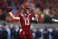 RALEIGH, NC - NOVEMBER 30: Devin Leary #13 of North Carolina State University throws a pass during a game between North Carolina and North Carolina State at Carter-Finley Stadium on November 30, 2019 in Raleigh, North Carolina.