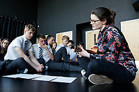 Pictured: Tic Ashfield (R) plays some of the music arranged on her guitar to Year 9 and 10 pupils as they rehearse Wales National Opera's Rhondda Rips It UP at of John Frost School in Newport, Wales, UK. Thursday 11 May 2018<br /> Re: Welsh National Opera is creating a new musical hall-style all female piece for the summer called Rhondda Rips It Up. It's about the life of suffragette Lady Rhondda with songs inspired by suffragette slogans. Opera opening next month in Newport, south Wales, where Lady Rhondda blew up a postbox with a home-made bomb and went to jail for.