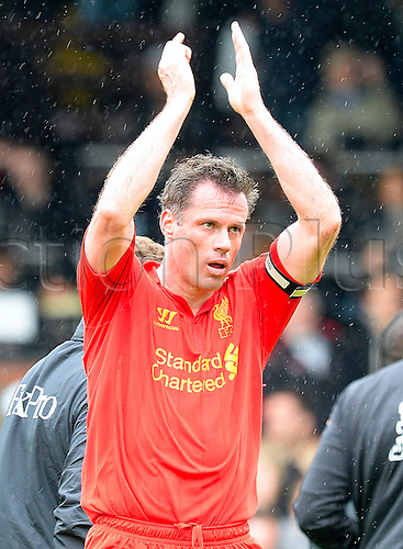 12.05.2013 London, England. Jamie Carragher of Liverpool celebrates after the win during the Premier League game between Fulham and Liverpool from Craven Cottage...