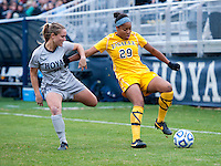 Emily Morgan (10) of Georgetown is held of by Deja Davis (29) of La Salle during the first round of the NCAA tournament at Shaw Field in Washington, DC.  Georgetown defeated La Salle, 2-0.