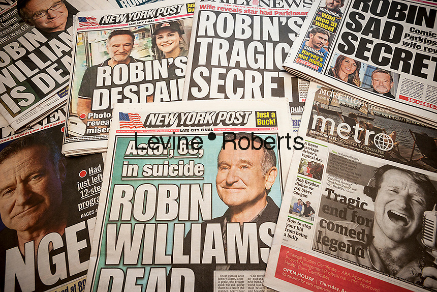 Front pages and headlines of New York tabloid newspapers over several days report on the August 11, 2014 death of actor and comedian Robin Williams. Williams died in his Marin County, CA home at the age of 63, an apparent suicide. (© Richard B. Levine)