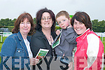 Eileen Hayes, Magella Creedon, Darragh Creedon and Susan Hayes all Killarney checking the form at the Killarney races on Monday.