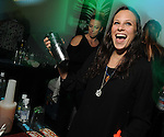 Bartender Michelle Bonich shakes up drink at Martini Madness at the Center for Contemporary Craft Thursday Jan. 22,2015.(Dave Rossman For the Chronicle)