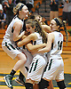 Carle Place trio, from left, No. 2 Elissa Frein, No. 1 Leah Burden and No. 14 Alexa Frein celebrate with teammates after their 62-58 overtime win over Oyster Bay in the Nassau County varsity girls basketball Class B final at LIU Post on Thursday, Feb. 18, 2016.