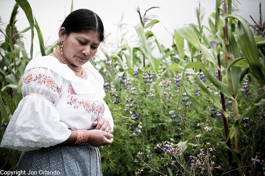 Laura Santillán , A member of The Pakarinka Sisari Ancestral Wisdom Center near Otavalo, Ecuador, pauses during a ritual before harvesting fava beans.