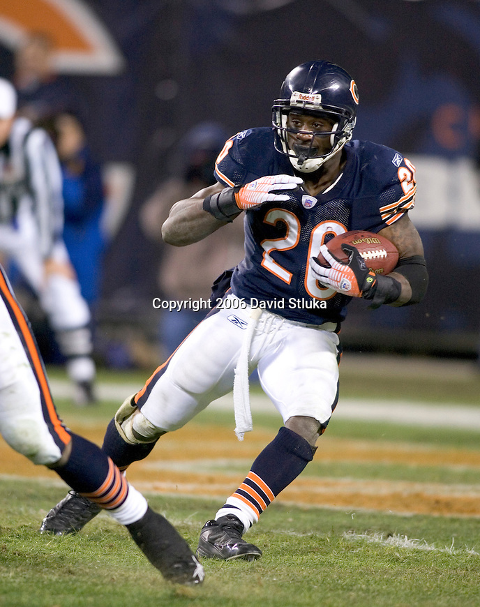 Running back Thomas Jones #20 of the Chicago Bears carries the ball during an NFL football game against the Carolina Panthers in their NFC Divisional Playoff game on January 15, 2006 at Soldier Field in Chicago, Illinois. The Panthers defeated the Bears 29-21. (Photo by David Stluka)