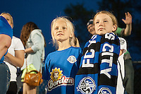 Kansas City, Mo. - Saturday April 23, 2016: Two young spectators look on as FC Kansas City hosts Portland Thorns FC at Swope Soccer Village. The match ended in a 1-1 draw.