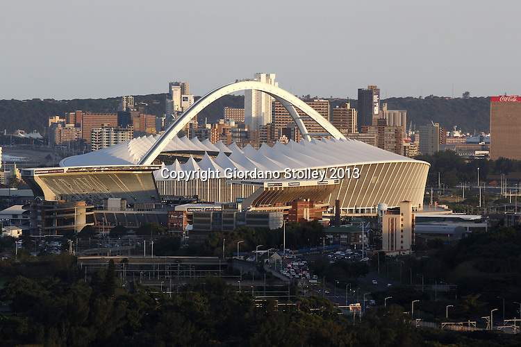 DURBAN - 16 August - 2013 - Durban's skyline in the late afternoon sun is dominated by the Moses Mabhida Stadium, used primarily for soccer matches and immediately infront of it is Kings Park Stadium, the home of rugby in the province. Buildings that line the city's beach, better known as the Golden Mile can be scene behind the stadium. Picture: Giordano Stolley