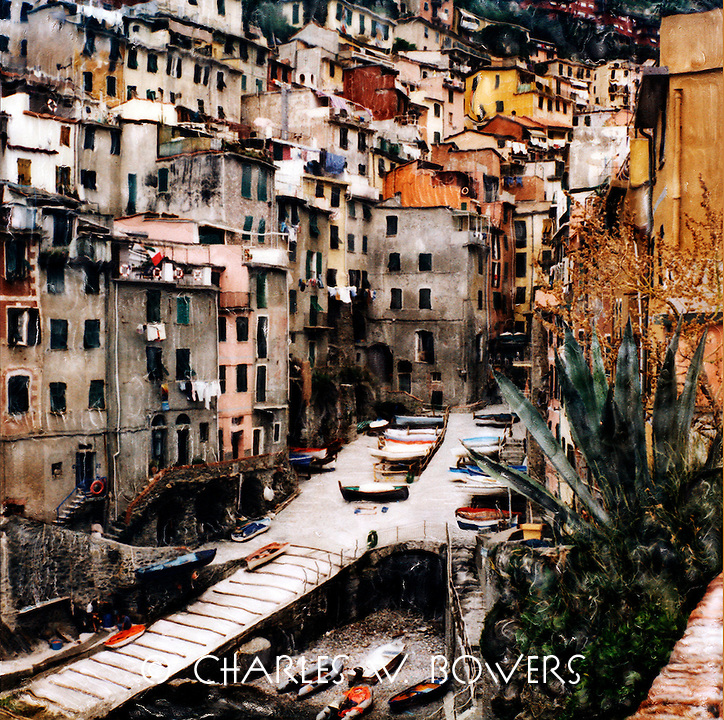 Riomaggiore main street and waterfront. Visit this wonderful Italian village in the Cinque Terra region of Italy.