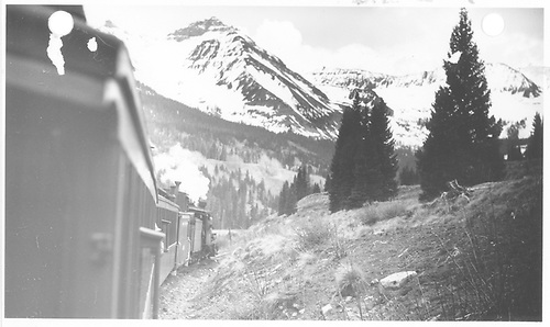 Leased D&amp;RGW #319 going downgrade from Lizard Head with photo taken from traim.  Pyramid Peak is in the background.<br /> RGS  Lizard Head, CO  Taken by Kindig, Richard H. - 5/31/1947