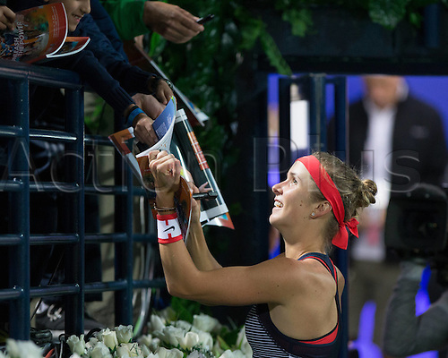 18.02.2016. Dubai, United Arab Emirates.  Elina Svitolina (UKR)  beats C Vandeweghe (US) at the Dubai Tennis Championships 2016 WTA and signs autographs for fans