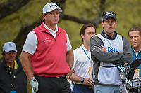 Phil Mickelson (USA) and his caddie/brother Tim wait to tee off on 1 during day 3 of the World Golf Championships, Dell Match Play, Austin Country Club, Austin, Texas. 3/23/2018.<br /> Picture: Golffile | Ken Murray<br /> <br /> <br /> All photo usage must carry mandatory copyright credit (&copy; Golffile | Ken Murray)
