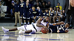 HIGH POINT, NC - JANUARY 06: High Point's Brandonn Kamga (left) beats Charleston Southern's Cortez Mitchell (2) to a lose ball. The High Point University of Panthers hosted the Charleston Southern University Buccaneers on January 6, 2018 at Millis Athletic Convocation Center in High Point, NC in a Division I men's college basketball game. HPU won the game 80-59.