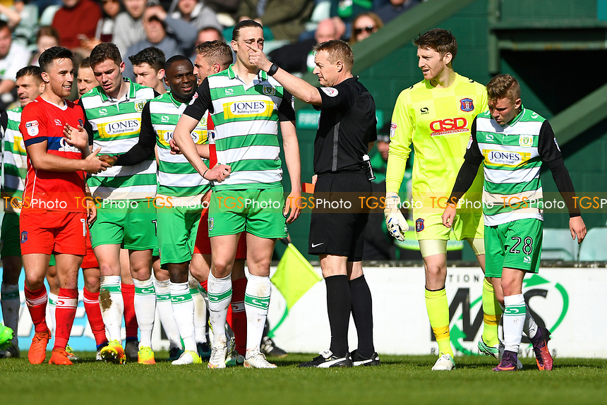 Referee Trevor Kettle  points to the dressing room after giving a straight red card to Ben Whitfield of Yeovil Town right during Yeovil Town vs Carlisle United, Sky Bet EFL League 2 Football at Huish Park on 1st April 2017