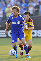 Michael Harrington (blue), Will Johnson...Kansas City Wizards and Real Salt Lake played to a 1-1 tie at Community America Ballpark, Kansas City, Kansas.