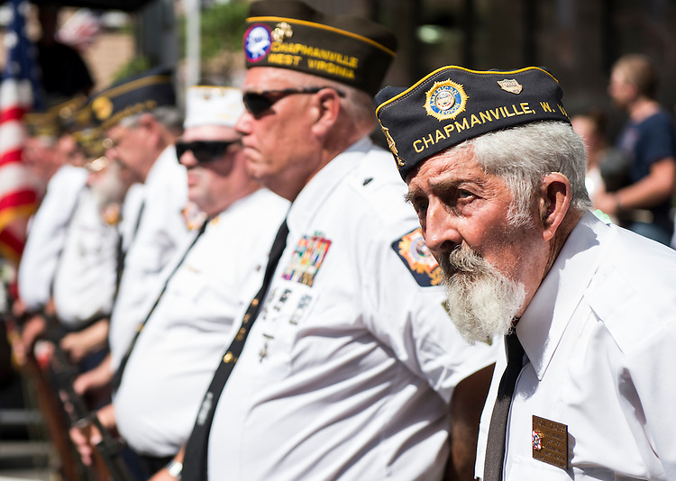 UNITED STATES - JULY 5: Local veterans stand in formation after firing rifles in salute during the presentation of the colors at the West Virginia Freedom Festival in downtown Logan, W. Va., on July 5, 2014. (Photo By Bill Clark/CQ Roll Call)