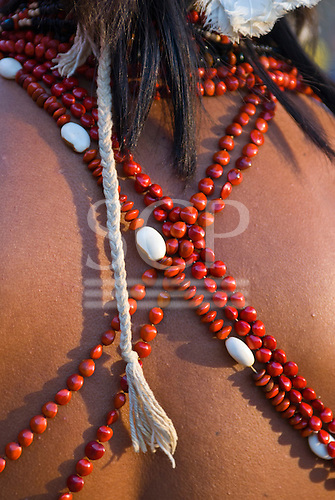 Brazil. Indian showing natural seed beadwork sash necklaces and plaited cotton cord.