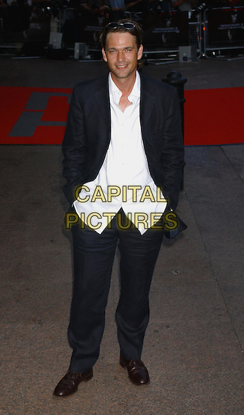 DOUGRAY SCOTT.Terminator 3 - Rise Of The Machines Premiere, Odeon Leicester Square, London.21st July 2003.full length, full-length, black suit.www.capitalpictures.com.sales@capitalpictures.com.Supplied By Capital PIctures