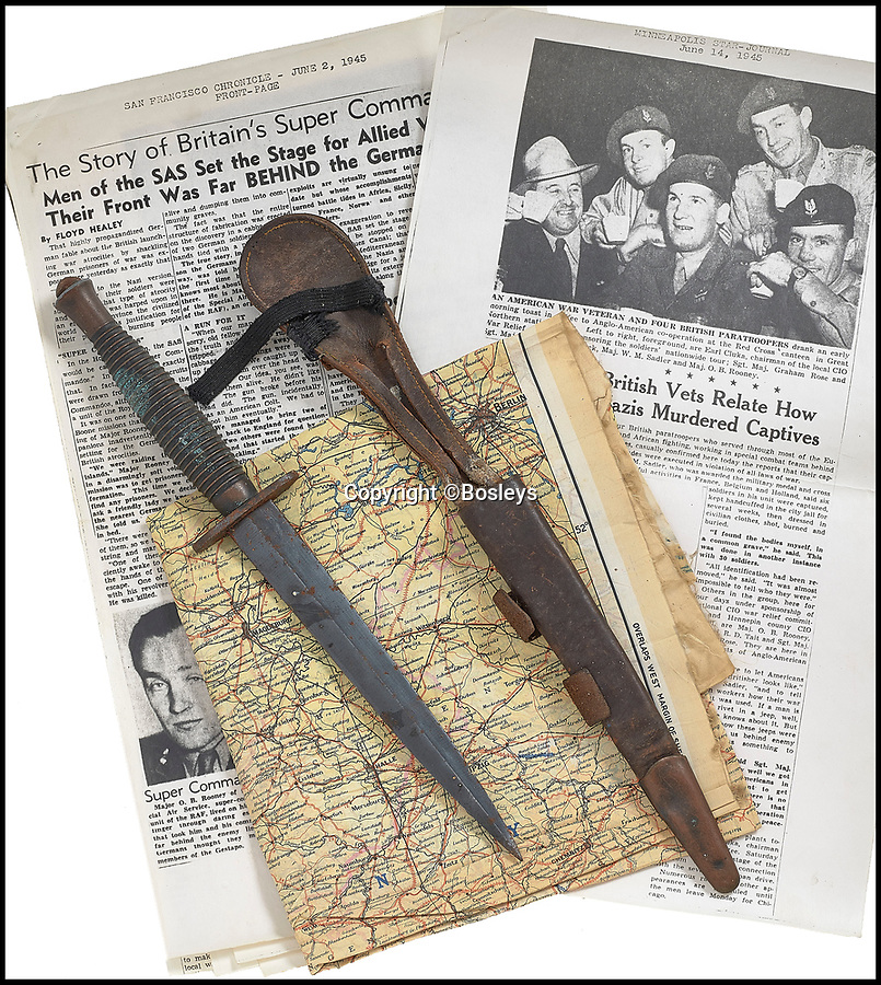BNPS.co.uk (01202 558833)Pic: Bosleys/BNPS<br /> <br /> Warrant Officer Bob Tait's dagger.<br /> <br /> The bravery medals awarded to the founding member of the SAS who designed its famous cap badge and took part in one of the regiment's most daring raids are to be sold.<br /> <br /> Warrant Officer Bob Tait was involved in the very first SAS mission in Libya in November 1941 which proved a disaster, with 22 men out of about 60 either killed or captured by the Germans.<br /> <br /> The second, though, was far more successful. W/O Tait was one of five commandos who snuck into a German aerodrome deep behind enemy lines and laid explosives that destroyed 37 aircraft.<br /> <br /> In between the raid he came up with the sword and wings insignia for the newly-formed regiment.<br /> <br /> His medals and other items are now being sold at auction for £50,000