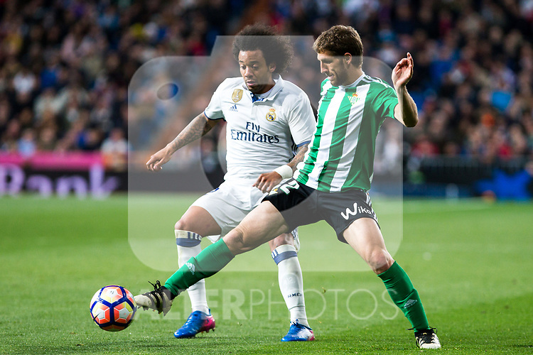 Darko Brasanac of Real Betis competes for the ball with Marcelo Vieira of Real Madrid  during the match of Spanish La Liga between Real Madrid and Real Betis at  Santiago Bernabeu Stadium in Madrid, Spain. March 12, 2017. (ALTERPHOTOS / Rodrigo Jimenez)