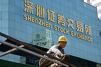 Construction labourers by Shenzhen Stock Exchange in China..