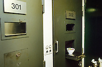 Switzerland. Bern. Regionalfgefängnis. Jail. Detention awaiting trial (commital for trial or pending trial). Loss of liberty.  Cells doors. Food distribution. Salad bowl. © 2005 Didier Ruef