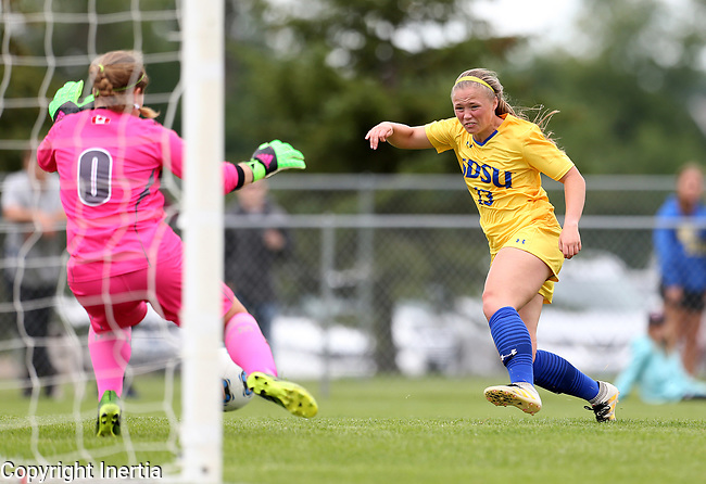 BROOKINGS, SD - AUGUST 13: Madison Chapman #13 from South Dakota State scores past goalie Camille Forbes #0 from Manitoba during the second half of their exhibition match Sunday afternoon at Fishback Soccer Park in Brookings. (Photo by Dave Eggen/Inertia)