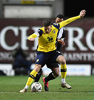 4th February 2020; Kassam Stadium, Oxford, Oxfordshire, England; English FA Cup Football; Oxford United versus Newcastle United; Nathan Holland of Oxford resists the tackle from Fabian Schar of Newcastle