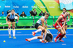 Lily Owsley #26 of Great Britain takes a backhand shot during Argentina vs Great Britain in women's Pool B game  at the Rio 2016 Olympics at the Olympic Hockey Centre in Rio de Janeiro, Brazil.