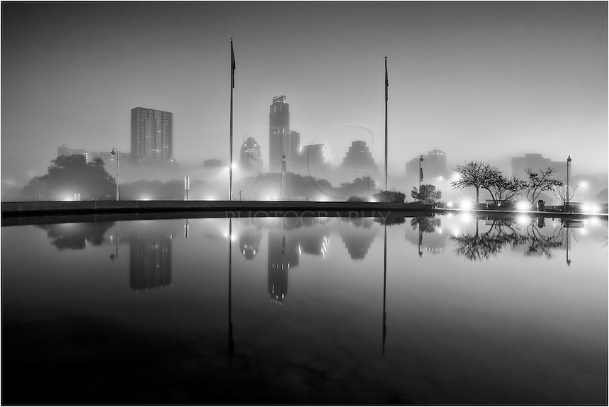 Taken from across Lady Bird Lake, this image reflects the Austin Skyline in the pool near the Long Center. It was well before dawn - still pretty dark outside, and the fog was low around downtown Austin.