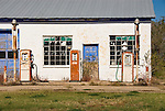 Abandoned gas station and rusty gas pumps on old Route 66, McLean, Texas.