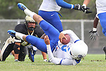 Palos Verdes, CA 09/16/11 - Lukas O'Connor (Culver City #3) and Jin Matsumoto (Peninsula #40) in action during the Culver City-Peninsula varsity football game.