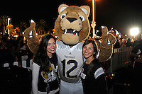 20 December 2011:  Tailgaters pose for a picture with FIU's mascot, Roary, prior to the game.  The Marshall University Thundering Herd defeated the FIU Golden Panthers, 20-10, to win the Beef 'O'Brady's St. Petersburg Bowl at Tropicana Field in St. Petersburg, Florida.
