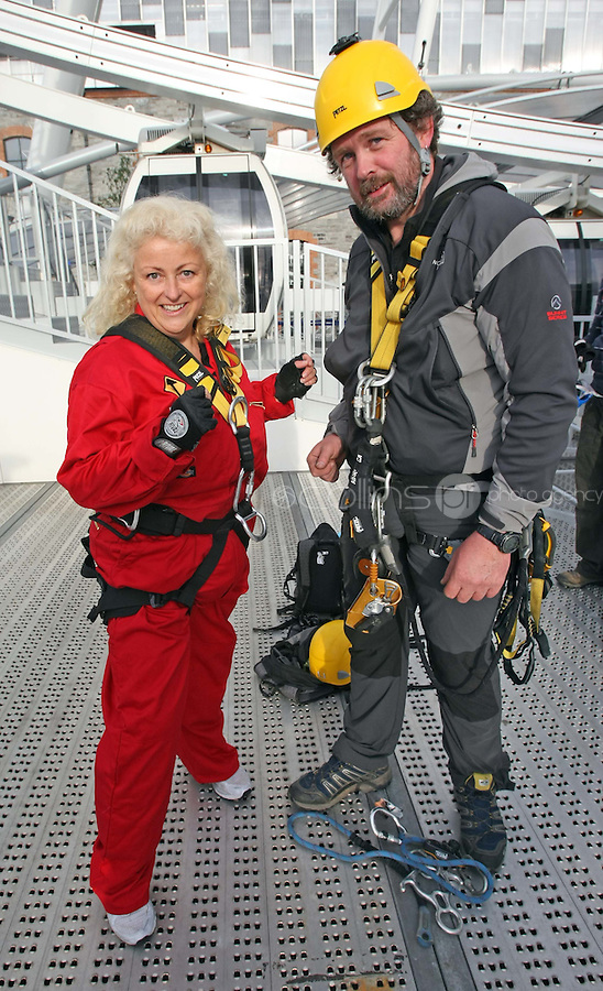 25/08/'10 Teena Gates, Head of News at 98FM pictured with Mike O'Shea of Work at Height  at the Wheel of Dublin at the O2 this morning preparing to abseil the 60 meters down from the top of the Wheel. After climbing her own personal mountain, recovering from illness, chronic back pain and loosing 10 stone in 12 months, Teena is heading to Mount Everest Base Camp this October as part of a celebrity fundraiser for the Hope Foundation and street kids in Calcutta....Picture Colin Keegan, Collins, Dublin.
