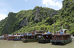 Halong-Vietnam, Ha Long - Viet Nam - 22 July 2005---Cruisers at Dau Go island - Halong Bay, a UNESCO World Natural Heritage Site---tourism, landscape, nature, transport---Photo: Horst Wagner/eup-images