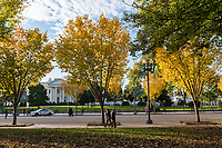 Commuters walk past the White House on Pennsylvania Avenue on a crisp fall morning in Washington, D.C. on November 2nd, 2017. <br />
