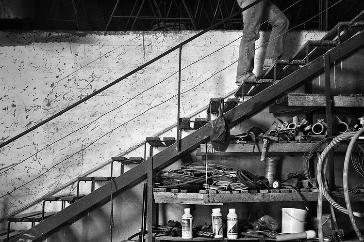 A figure going up stairs from a garage store