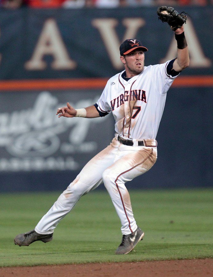 Virginia infielder Branden Cogswell (7) makes a catch during the game against Arkansas Saturday night at Davenport Field in Charlottesville, VA. Photo/The Daily Progress/Andrew Shurtleff