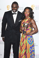 Idris Elba and Michaela Coel<br /> in the winners room at the 2016 BAFTA TV Awards, Royal Festival Hall, London<br /> <br /> <br /> &copy;Ash Knotek  D3115 8/05/2016